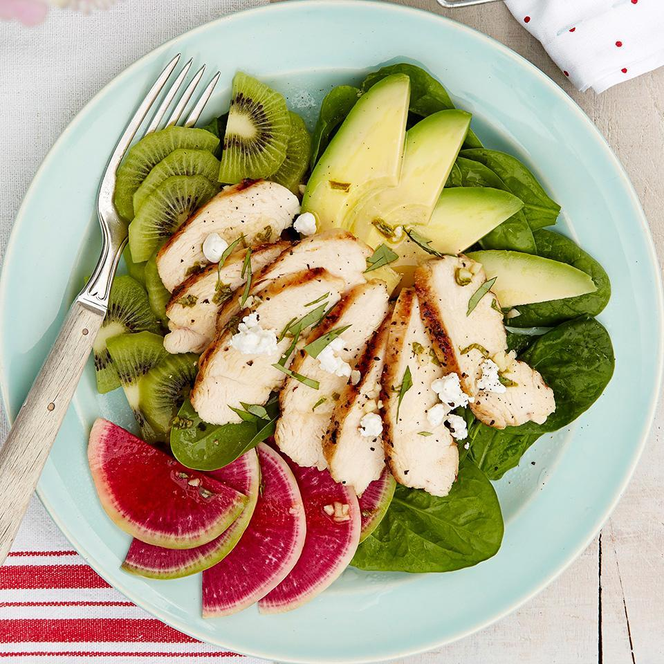 <p>This light lunch salad is full of flavor and texture. Sweet kiwi, creamy avocado and spicy radishes combine with grilled chicken in a lime and basil flavored dressing.</p>
