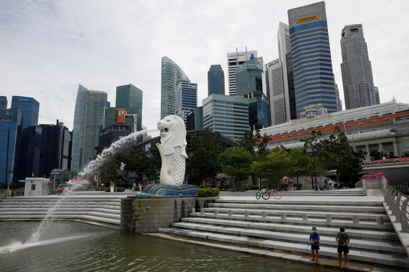 FILE PHOTO: Youth fish at a largely empty Merlion Park in Singapore