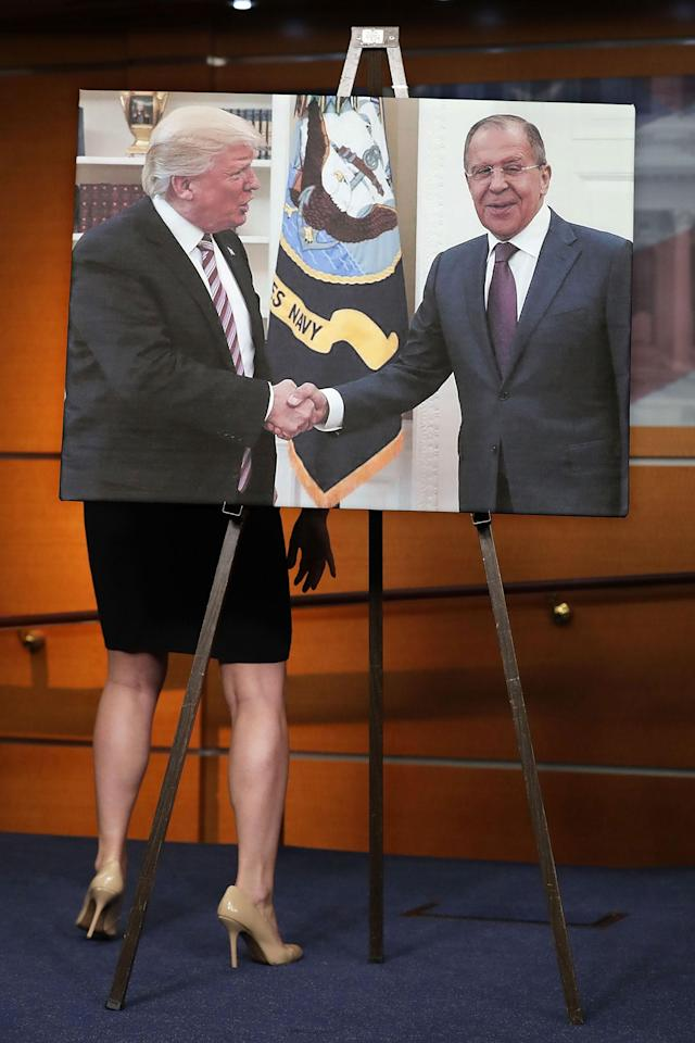 <p>MAY 17, 2017 – House Democrats display a photograph of President Donald Trump welcoming Russian Foreign Minister Sergey Lavrov to the White House during a news conference at the U.S. Capitol in Washington, DC. House Democrats have introduced legislation to create an outside, independent commission to investigate possible connections between President Donald Trump and Russian officials. If Speaker Paul Ryan (R-WI) does not support the legislation then Democrats said they will file a discharge petition to force a vote on the measure. (Photo: Chip Somodevilla/Getty Images) </p>