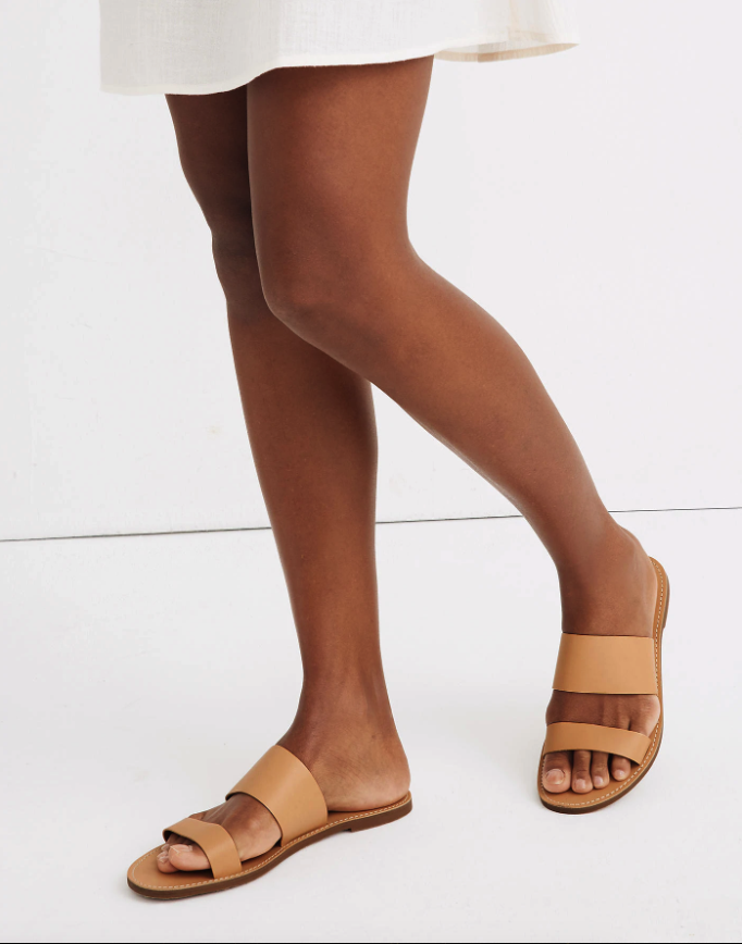 """<h2>Madewell</h2><br><strong>Deal: Extra 50% Off</strong><br>Using code """"<strong>GIANT</strong>"""", shoppers can currently snag a pair of the brand's <a href=""""https://www.madewell.com/womens/shoes/sandals"""" rel=""""nofollow noopener"""" target=""""_blank"""" data-ylk=""""slk:bestselling summer sandals for 40% off"""" class=""""link rapid-noclick-resp"""">bestselling summer sandals for 40% off</a> — or, they can push their carts on over to the <a href=""""https://www.madewell.com/womens/sale/extra-50-off-select-sale-styles"""" rel=""""nofollow noopener"""" target=""""_blank"""" data-ylk=""""slk:extra 50%-off clearance styles' section"""" class=""""link rapid-noclick-resp"""">extra 50%-off clearance styles' section</a> for even steeper discounts on open-toed pairs. <br><br><em>Shop</em> <strong><em><a href=""""https://www.madewell.com"""" rel=""""nofollow noopener"""" target=""""_blank"""" data-ylk=""""slk:Madewell"""" class=""""link rapid-noclick-resp"""">Madewell</a></em></strong><br><br><strong>Madewell</strong> The Boardwalk Double-Strap Slide Sandal, $, available at <a href=""""https://go.skimresources.com/?id=30283X879131&url=https%3A%2F%2Fwww.madewell.com%2Fthe-boardwalk-double-strap-slide-sandal-AH748.html"""" rel=""""nofollow noopener"""" target=""""_blank"""" data-ylk=""""slk:Madewell"""" class=""""link rapid-noclick-resp"""">Madewell</a>"""