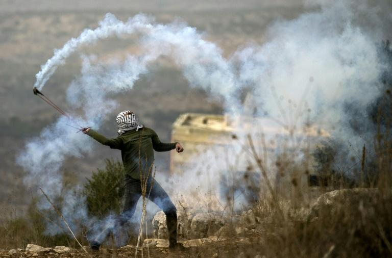 Palestinian protesters hold weekly demonstrations in the West Bank village of Kfar Qaddum against Israeli expropriation of their land to make way for homes for settlers (AFP Photo/JAAFAR ASHTIYEH)