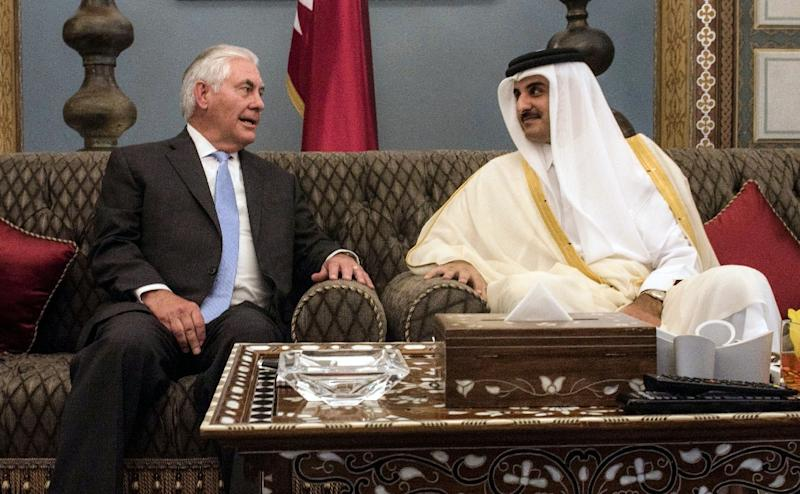 A handout picture provided by the US Embassy in Doha's Offical Twitter account on July 11, 2017 shows US Secretary of State Rex Tillerson (L) meeting with Qatar's Emir Sheikh Tamim bin Hamad Al-Thani in Doha (AFP Photo/Handout)