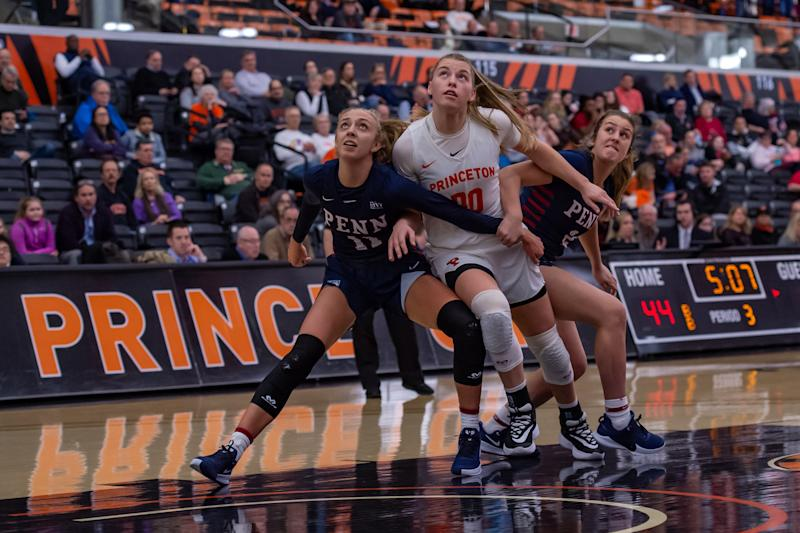 PRINCETON, NJ - FEBRUARY 25: Princeton Tigers forward Ellie Mitchell (00) fights for position with Pennsylvania Quakers guard Kendall Grasela (11) during the Ivy League college basketball game between the Penn Quakers and Princeton Tigers on February 25, 2020 at Jadwin Gymnasium in Princeton, NJ (Photo by John Jones/Icon Sportswire via Getty Images)