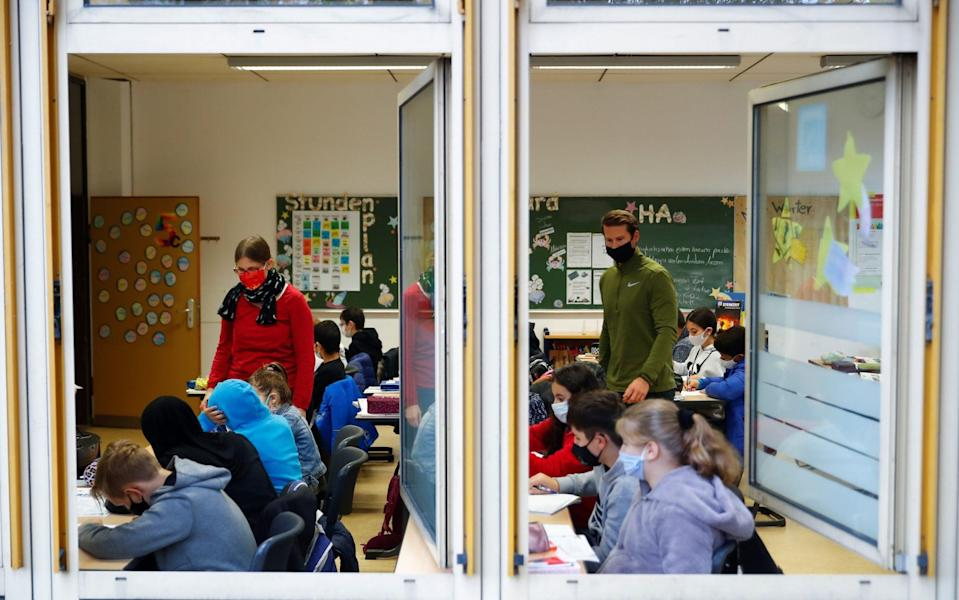 Classroom window of Freiherr-vom-Stein secondary school in the North Rhine-Westphalian city of Bonn stays open for venting - WOLFGANG RATTAY/REUTERS