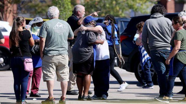 PHOTO: A crowd gathers outside the Kroger on New Byhalia Road where a shooting took place in Collierville, Tenn., Sept. 23, 2021. (Joe Rondone / The Commercial Appeal via USA Today Network)