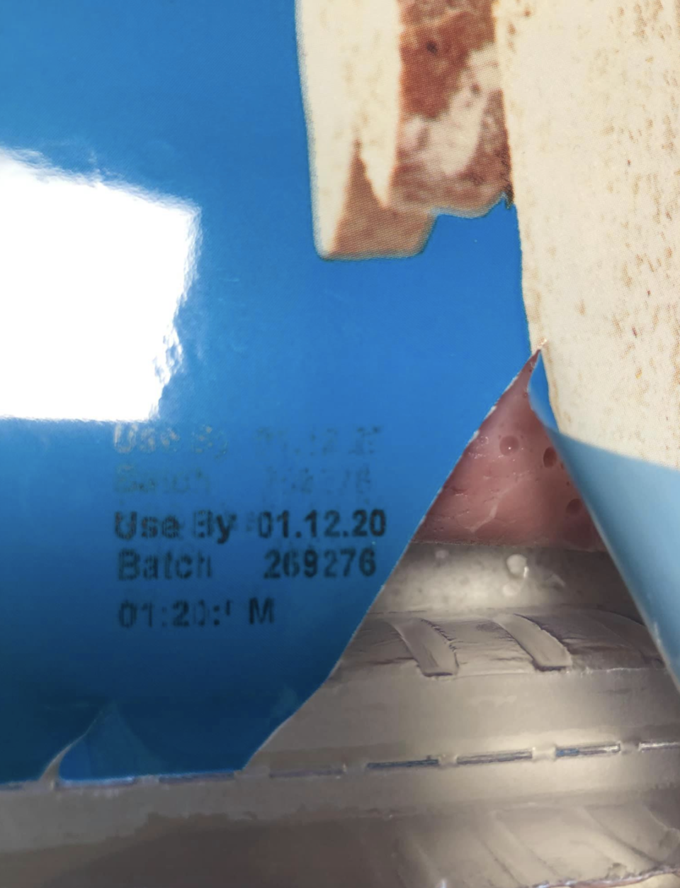 Ham pack from Aldi with meat's used by date.