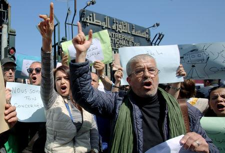 Journalists working at state media carry banners and shout slogans during a protest in front of the state TV building to demand freedom to cover mass protests against President Abdelaziz Bouteflika, in Algiers, Algeria March 25, 2019. REUTERS/Ramzi Boudina