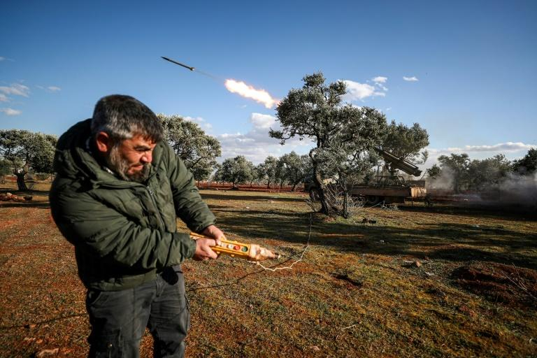 Rebel fighters have exchanged fire with Syrian regime forces in Idlib province (AFP Photo/Omar HAJ KADOUR)