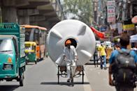 NEW DELHI, INDIA - JUNE 10: A cycle rickshaw puller transports a 5000 litre capacity water tank on a summer day on June 10, 2019 in New Delhi, India. The mercury shattered all records in Delhi NCR on Monday with parts of the national capital region recording an all-time high of 48 degrees Celsius for the month of June. (Photo by Amal KS/Hindustan Times via Getty Images)