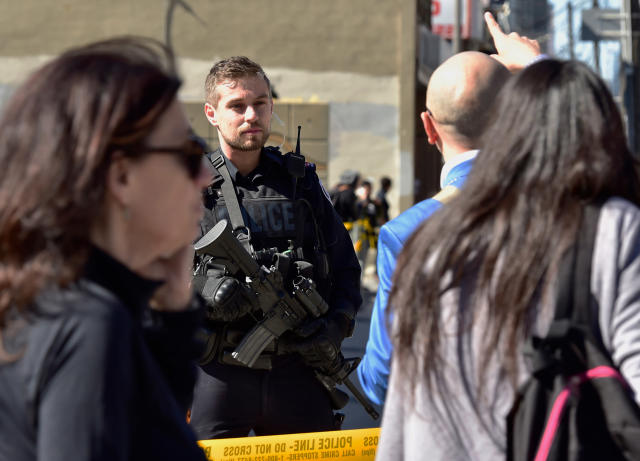 <p>A Toronto police officer stands guard at the police line after a van mounted a sidewalk crashing into pedestrians in Toronto on Monday, April 23, 2018. (Photo: Frank Gunn/The Canadian Press via AP) </p>