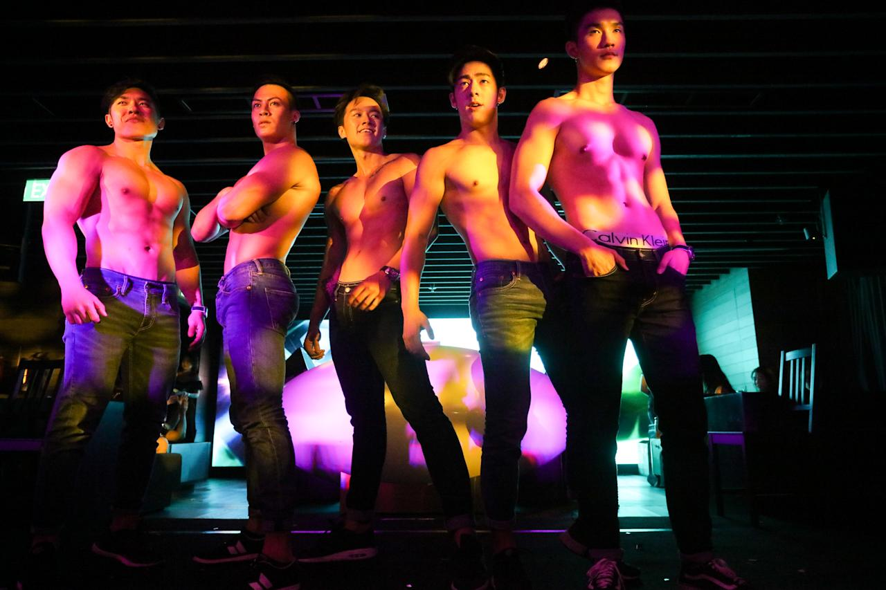<p>Bachelors pose after performing a dance routine during the finals of CLEO Most Eligible Bachelors 2018 at Capital, Zouk at Clark Quay. (PHOTO: Don Wong) </p>