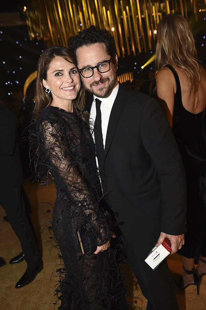 <p>Keri Russell and J.J. Abrams caught up at the Governors Ball. (Photo: Al Powers/Invision for the Television Academy/AP Images) </p>