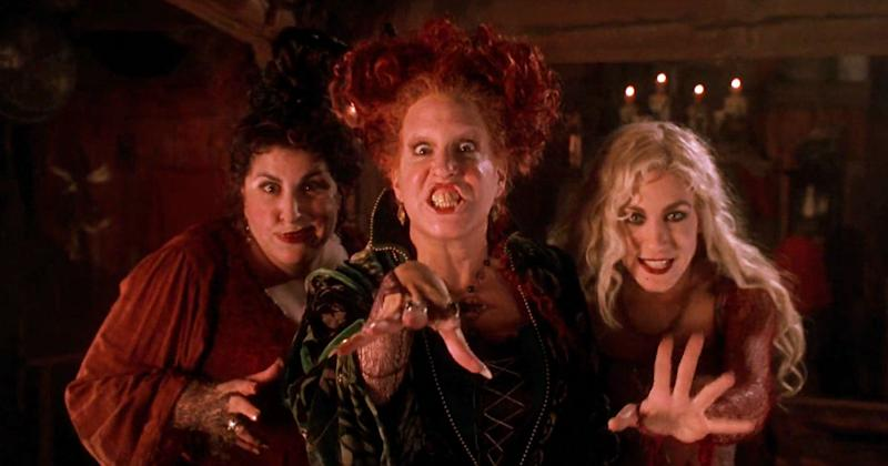 a movie still from hocus pocus with bette midler, kathy majimy and sarah jessica parker looking at the camera