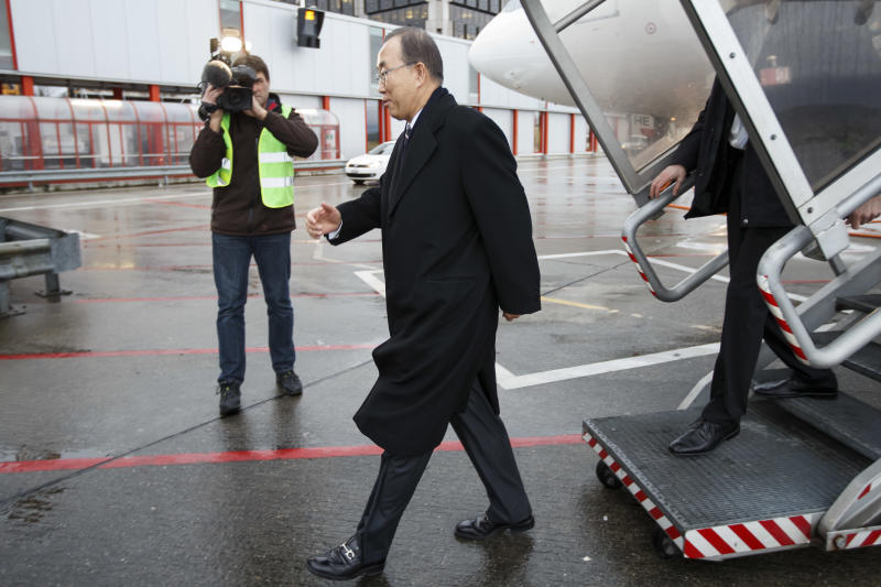 United Nations Secretary-General Ban Ki-moon arrives at Geneva International airport, in Geneva, Switzerland, Tuesday, Jan. 21, 2014. Ban Ki-moon arrived to join this week's Syria peace talks in Montreux and Geneva. (AP Photo/Salvatore Di Nolfi, pool)