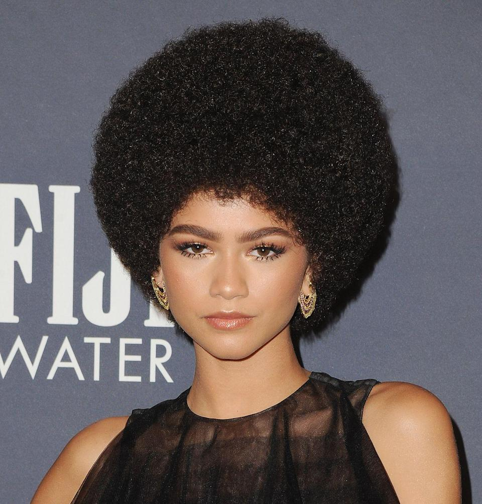 <p>A rounded fro and spiky lower lashes screams '70s era Diana Ross.</p>