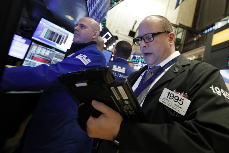 Specialist Mark Fitzgerald, left, and trader Jeffrey Vazquez work on the floor of the New York Stock Exchange, Wednesday, Jan. 9, 2019. Stocks are opening higher on Wall Street, putting the market on track for a fourth gain in a row. (AP Photo/Richard Drew)