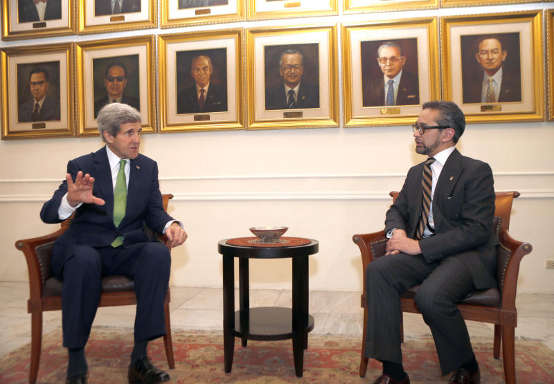 U.S. Secretary of State John Kerry, left, gestures during a meeting with Indonesian Foreign Minister Marty Natalegawaat the Foreign Ministry office in Jakarta, Indonesia Monday, Feb. 17, 2014. (AP Photo/Adi Weda, Pool)