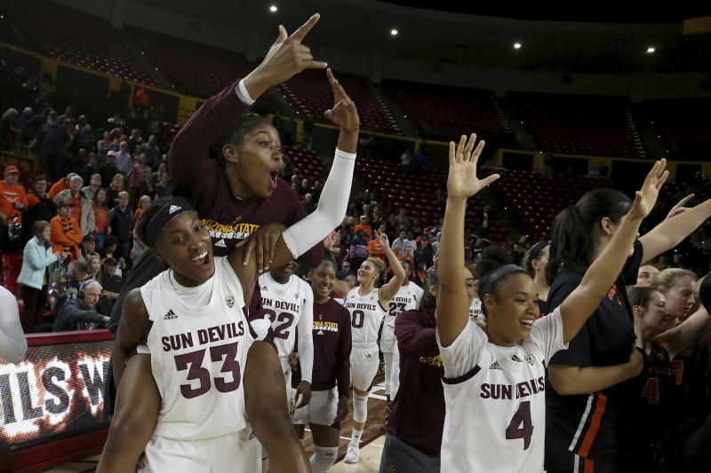 Arizona State players celebrate their upset win over Oregon State at the end of an NCAA college basketball game Sunday, Jan. 12, 2020, in Tempe, Ariz. (AP Photo/Darryl Webb)