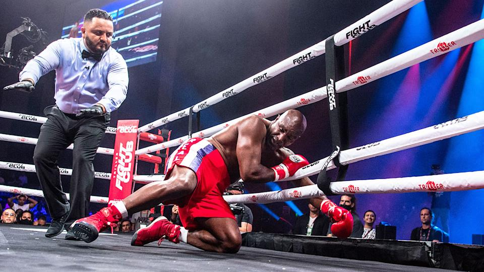 Seen here, Evander Holyfield slips through the ropes after a wild punch against Vitor Belfort.