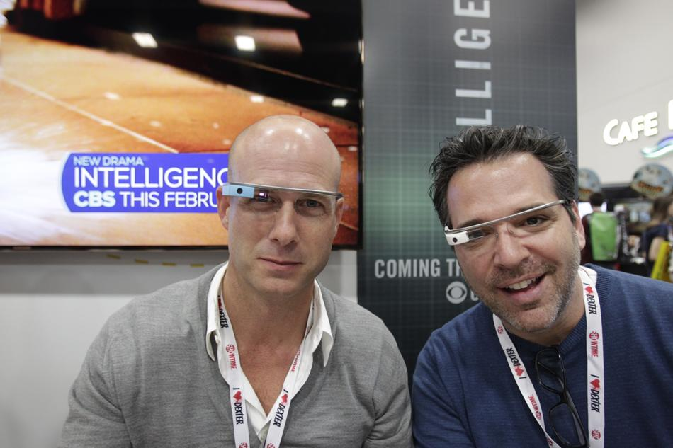 """Producers Michael Seitzman and Tripp Vinson at the """"Intelligence"""" booth signing during Comic-Con International 2013 at San Diego Convention Center on July 18, 2013 in San Diego, California."""
