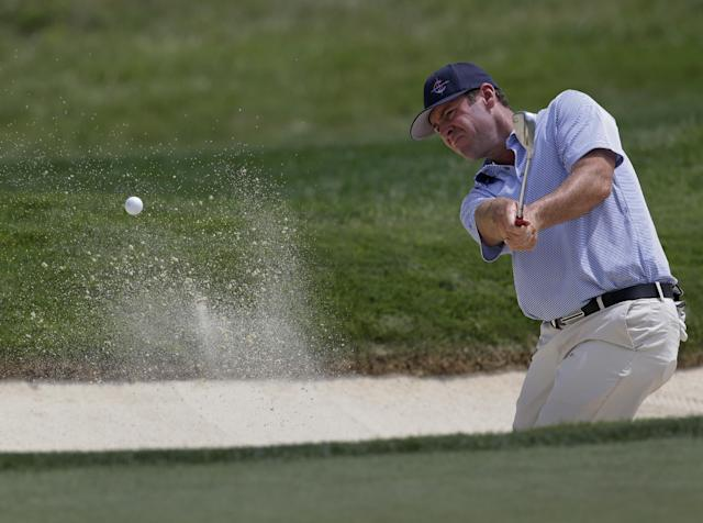 Rob Corcoran hits out of the bunker on the fifth hole during a practice round for the PGA Championship golf tournament at Valhalla Golf Club on Tuesday, Aug. 5, 2014, in Louisville, Ky. The tournament is set to begin on Thursday. (AP Photo/John Locher)