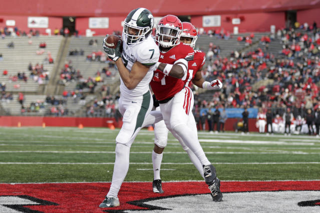 Michigan State wide receiver Cody White (7) catches a touchdown pass in front of Rutgers defensive back Tim Barrow during the first half of an NCAA college football game Saturday, Nov. 23, 2019, in Piscataway, N.J. (AP Photo/Adam Hunger)