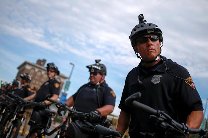 <p>Police officers use bicycles to create cordons around a protest march by various groups, including Black Lives Matter and Shut Down Trump and the RNC, ahead of the Republican National Convention in Cleveland, Ohio, on July 17, 2016. (Photo: Adrees Latif/Reuters)</p>