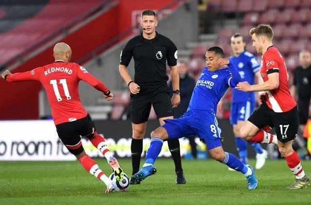 Leicester's Youri Tielemans (centre) in action