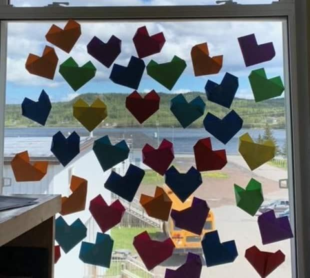 Grade 4-6 students at Point Leamington Academy created 215 paper hearts this week to mark the discovery of remains found at a former British Columbia residential school.