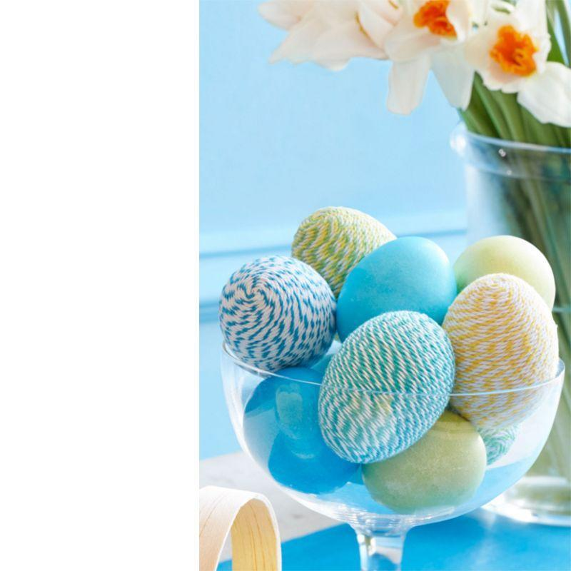 <p>How cool is this textured twine-wrapped Easter egg idea? Adhere twine to one end of a ceramic egg with a glue stick, then apply glue and tightly wind the twine, working in sections, until you've completely covered the surface.</p>