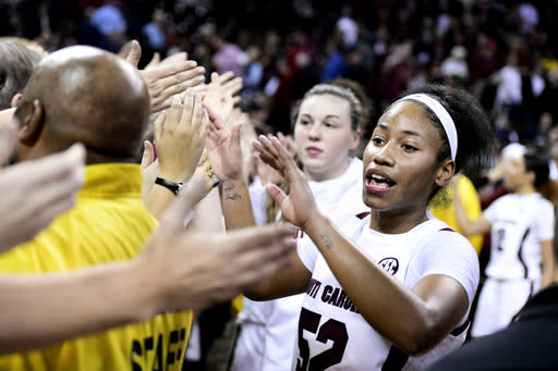 South Carolina guard Tyasha Harris (52) celebrates a win over Connecticut with fans after an NCAA college basketball game Monday, Feb. 10, 2020, in Columbia, S.C. (AP Photo/Sean Rayford)