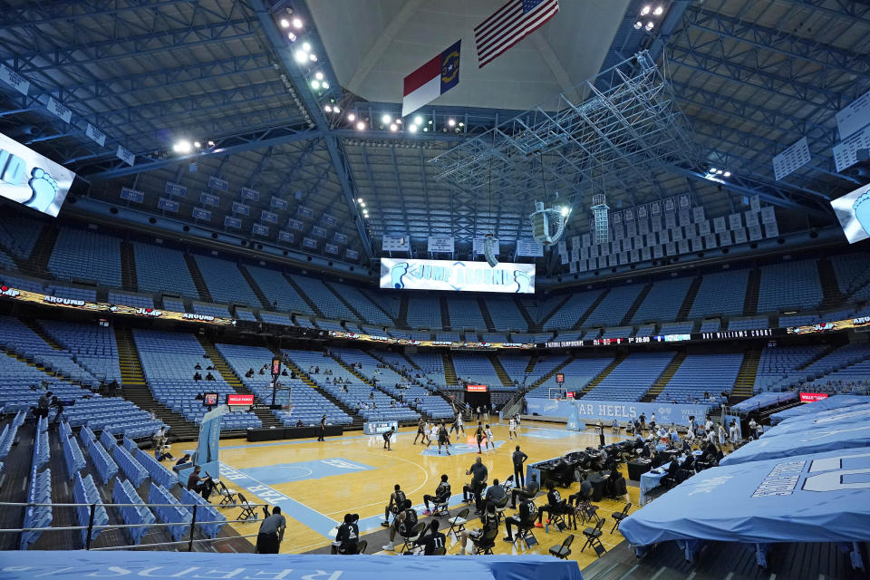 North Carolina and College of Charleston tip off in front a limited crowd due to COVID-19 restrictions, at the Dean E. Smith Center during the first half of an NCAA basketball game in Chapel Hill, N.C., Wednesday, Nov. 25, 2020. (AP Photo/Gerry Broome)