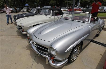 A man walks past a row of 1954 Mercedes-Benz cars at an annual Mercedes-Benz pageant in Colombo September 15, 2013. REUTERS/Dinuka Liyanawatte