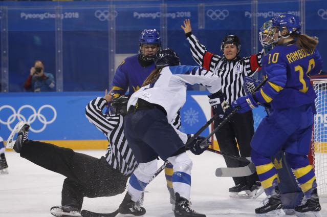 Ice Hockey - Pyeongchang 2018 Winter Olympics - Women's Quarterfinal Match - Finland v Sweden - Kwandong Hockey Centre, Gangneung, South Korea - February 17, 2018 - A referee falls during a scuffle between Sweden's Emma Nordin and Susanna Tapani of Finland. REUTERS/Kim Kyung-Hoon