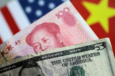 U.S. dollar and China yuan notes are seen in this picture illustration June 2, 2017. REUTERS/Thomas White/Illustration/Files