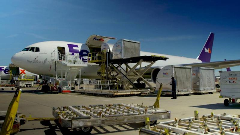 Loading cargo onto FedEx Express plane
