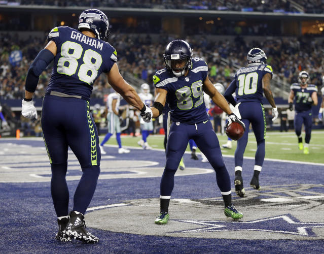 The Seahawks' Jimmy Graham congratulates Doug Baldwin on his touchdown catch against the Cowboys. Graham caught his ninth touchdown of the year as well, which leads all tight ends. (AP)
