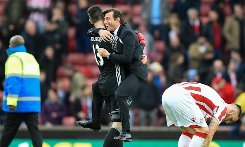 Antonio Conte asks for a lift to the changing room from his goalkeeper, Thibaut Courtois.