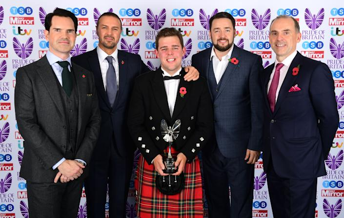 Fraser Johnston (centre) is presented the TSB Community Partner award by Jimmy Carr (left), Paddy McGuinness and Jason Manford (2nd from right) during The Pride of Britain Awards 2017, at Grosvenor House, Park Street, London. Picture Date: Monday 30 October. Photo credit should read: Ian West/PA Wire
