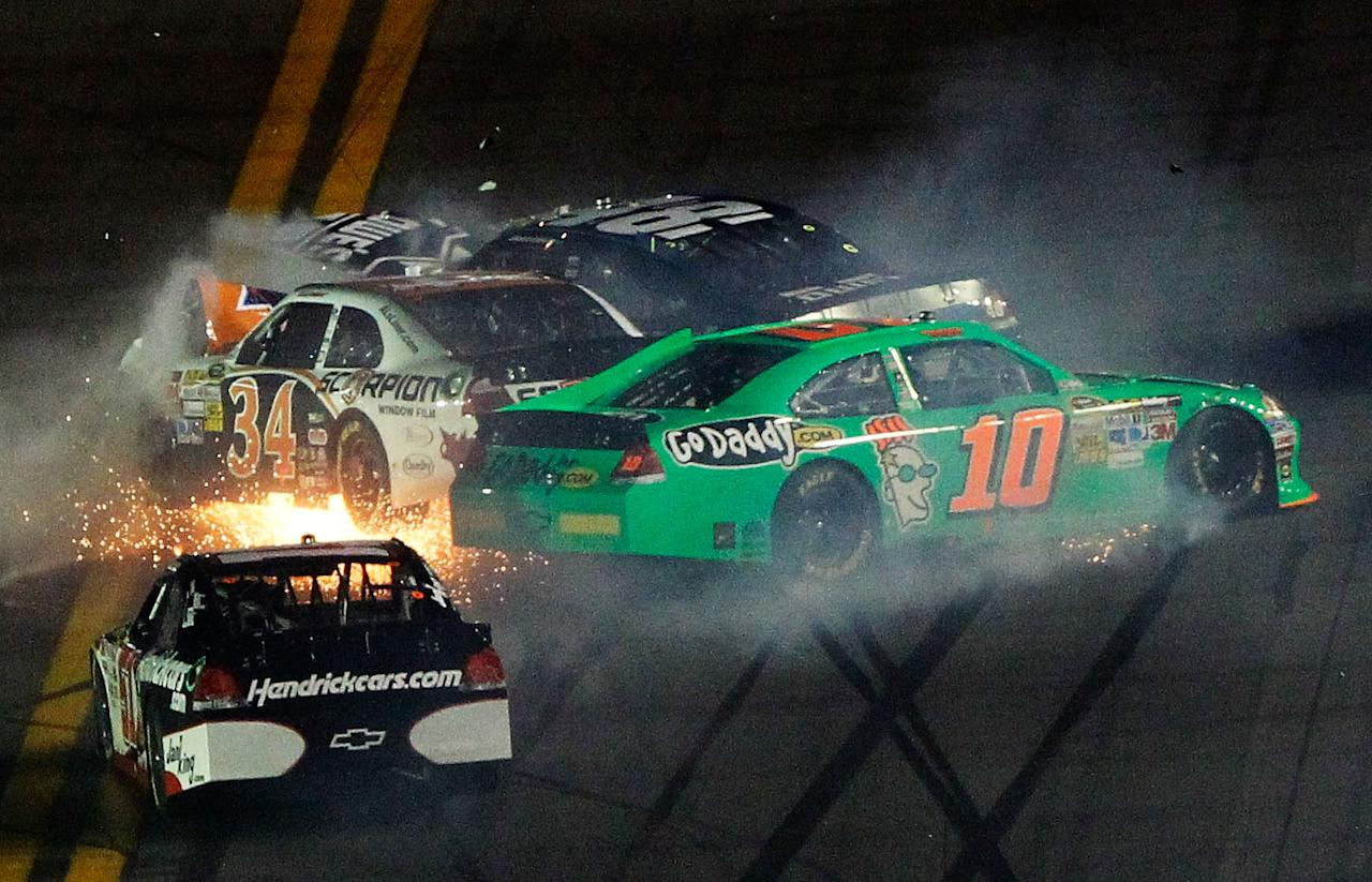 DAYTONA BEACH, FL - FEBRUARY 27:  Danica Patrick, driver of the #10 GoDaddy.com Chevrolet, David Ragan, driver of the #34 Front Row Motorsports Ford, and Jimmie Johnson, driver of the #48 Lowe's Chevrolet, spin after an on track incident in the NASCAR Sprint Cup Series Daytona 500 at Daytona International Speedway on February 27, 2012 in Daytona Beach, Florida.  (Photo by Tom Pennington/Getty Images for NASCAR)