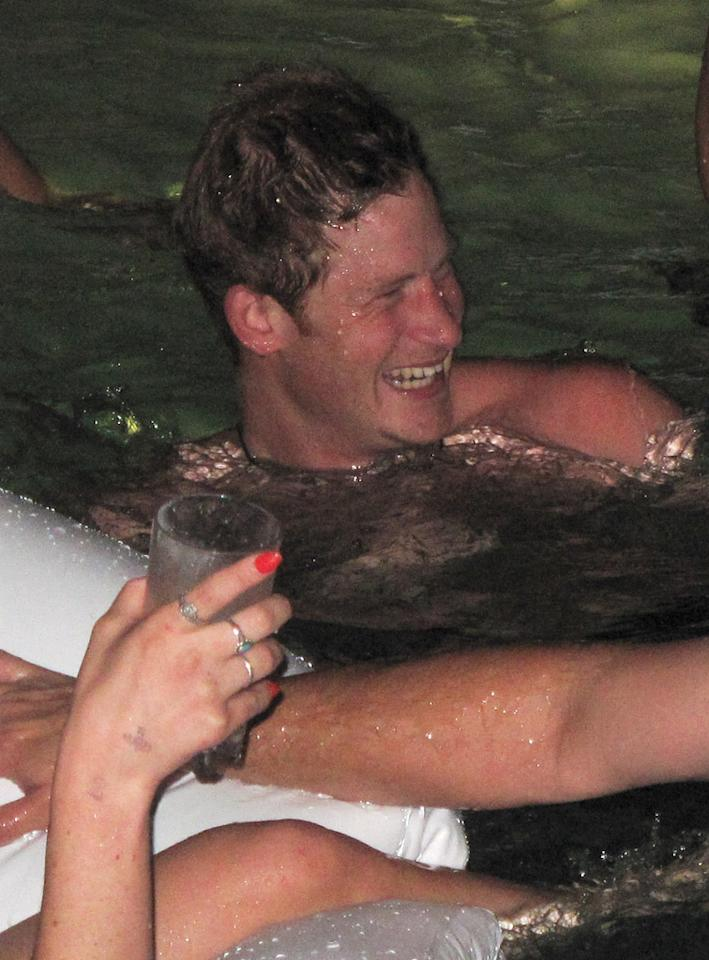 "EXCLUSIVE: **PREMIUM RATES APPLY** Prince Harry parties at XS Nightclubs ""Sunday Night Swim Party"". Prince Harry was at a pool side daybed with friends, ladies and heavy security. Harry arrived in a blue button-up shirt, but soon took it off and jumped in the pool with only his blue jeans. He had gun being on the Swan floatie and tipping his boys off it. He was also joined by random ladies on the swan for a while. Pictured: Prince Harry Ref: SPL429616 260812 EXCLUSIVE Picture by: EBLV / Splash News Splash News and Pictures Los Angeles: 310-821-2666 New York: 212-619-2666 London: 870-934-2666 photodesk@splashnews.com"