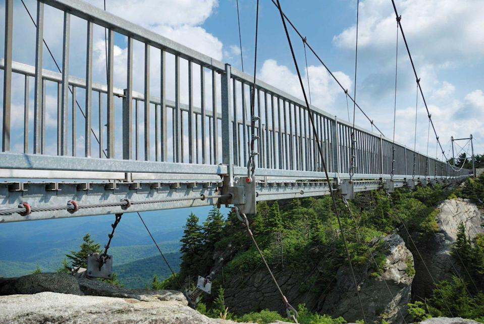 """<p><strong>Grandfather Mountain</strong></p><p><a href=""""https://grandfather.com/"""" rel=""""nofollow noopener"""" target=""""_blank"""" data-ylk=""""slk:Grandfather Mountain"""" class=""""link rapid-noclick-resp"""">Grandfather Mountain</a> in Linville, North Carolina, is a day of fun for hikes of all ages. Offering unbeatable views and different level trails, the Mile High Swinging Bridge is as exciting as it sounds.</p>"""