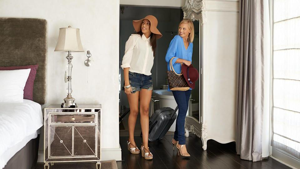 two women arriving to their holiday room.
