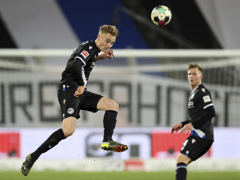 Bielefeld's defender Amos Pieper in action during the match against Union, during their German Bundesliga soccer match at Sch'co Arena in Bielefeld, Germany, Sunday March 7, 2021. (Friso Gentsch/dpa via AP)