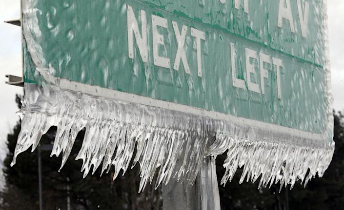 Icicles, formed by freezing rain and stiff winds, hang from a road sign along Interstate 84 in Troutdale, Ore., Wednesday, Jan. 18, 2017. An ice storm shut down parts of major highways and interstates Wednesday in Oregon and Washington state and paralyzed the hardest hit towns along the Columbia River Gorge with up to 2 inches of ice coating the ground in some places. (AP Photo/Don Ryan)