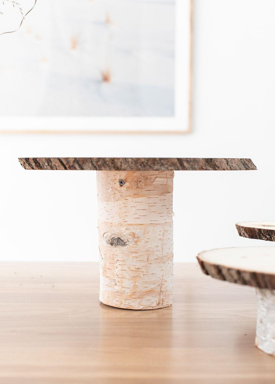 """<p>If you're going to bake a pie from scratch, you might as well show it off properly. This rustic cake stand gives you the chance to do just that—and it's inexpensive to boot.</p><p><strong>Get the tutorial at <a href=""""https://sugarandcharm.com/diy-thanksgiving-dessert-table"""" rel=""""nofollow noopener"""" target=""""_blank"""" data-ylk=""""slk:Sugar and Charm"""" class=""""link rapid-noclick-resp"""">Sugar and Charm</a>.</strong></p><p><strong><a class=""""link rapid-noclick-resp"""" href=""""https://www.amazon.com/Fuyit-4-7-5-1-Unfinished-Christmas-Ornaments/dp/B085Q1SCNZ/ref=sr_1_2_sspa?tag=syn-yahoo-20&ascsubtag=%5Bartid%7C10050.g.2063%5Bsrc%7Cyahoo-us"""" rel=""""nofollow noopener"""" target=""""_blank"""" data-ylk=""""slk:SHOP WOOD SLICES"""">SHOP WOOD SLICES</a><br></strong></p>"""