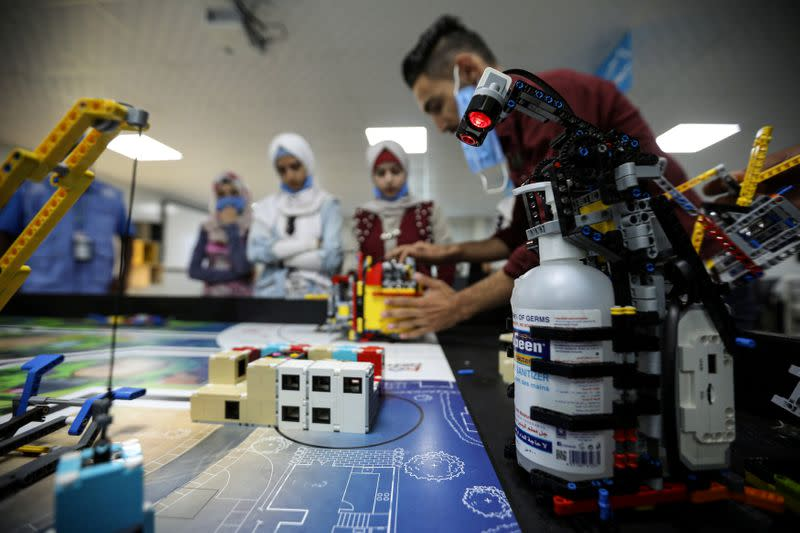 FILE PHOTO: Teenagers at the Syrian refugee Zaatari camp develop lego-based robots