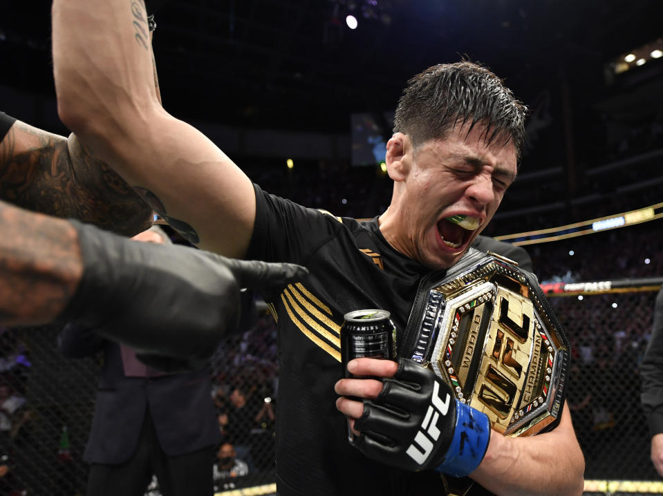 GLENDALE, ARIZONA - JUNE 12: Brandon Moreno of Mexico reacts after submitting Deiveson Figueiredo of Brazil to win the UFC flyweight championship fight during the UFC 263 event at Gila River Arena on June 12, 2021 in Glendale, Arizona. (Photo by Jeff Bottari/Zuffa LLC)