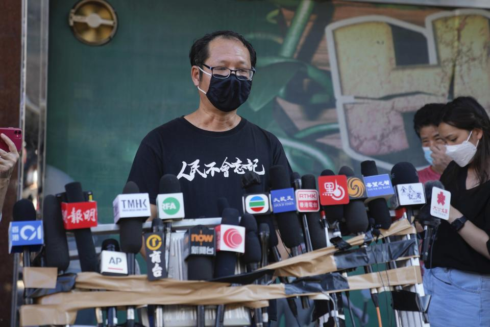 Spokesperson of Hong Kong Alliance in Support of Patriotic Democratic Movements of China, Richard Tsoi speaks to media after the group announced that it's disbanded in Hong Kong, Saturday, Sept. 25, 2021. (AP Photo/Kin Cheung)