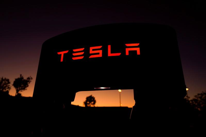 FILE PHOTO: A Tesla supercharger is shown at a charging station in Santa Clarita, California